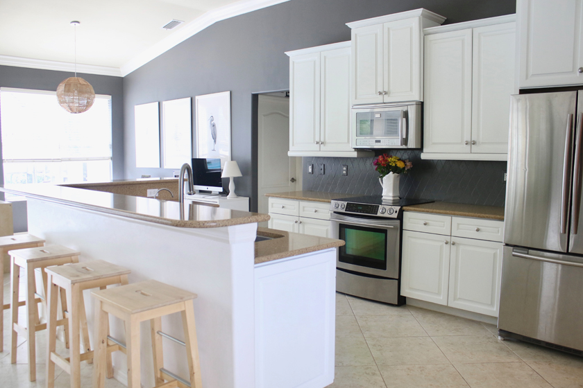 White and gray kitchen - painted cabinets and tile backsplash