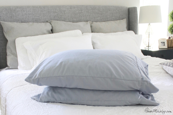 Colored pillowcases on an all white bed are easier to clean