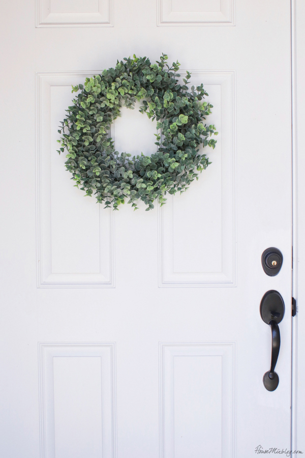 A wreath and new door handle are easy updates that make a big difference
