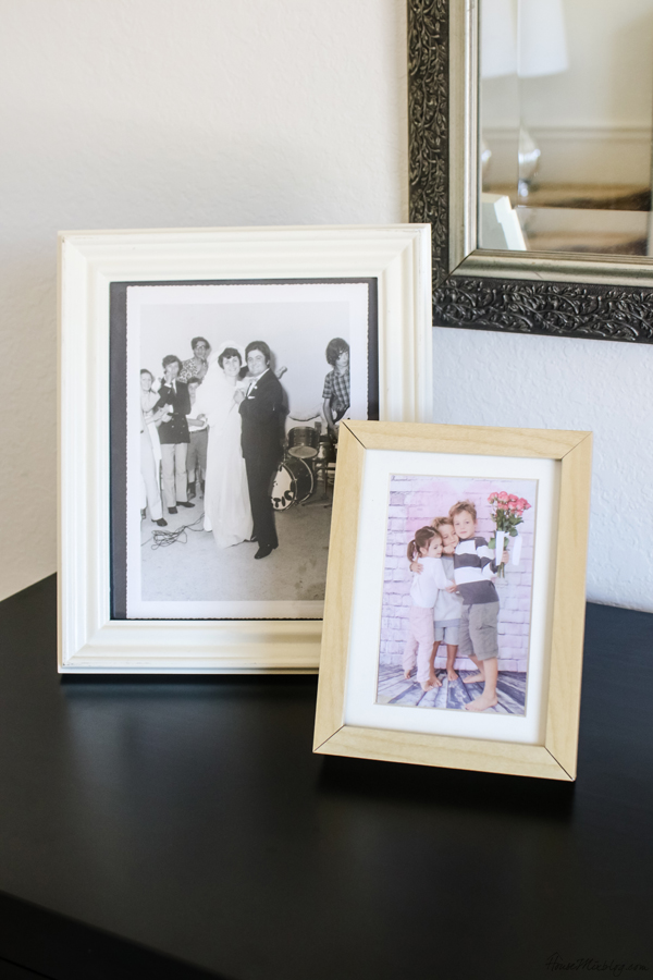 Framed photos on bedroom dresser