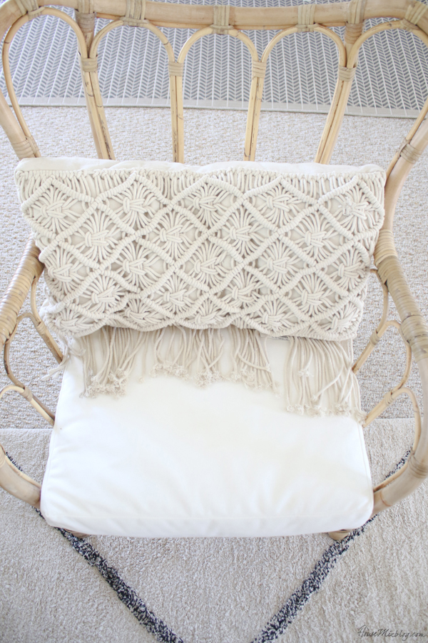 Macrame pillow and rattan chair