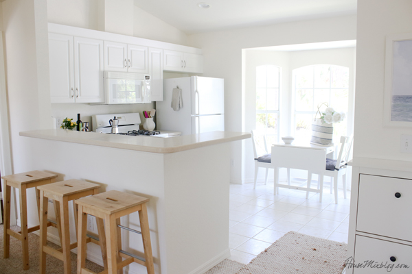 small all white kitchen and bar area