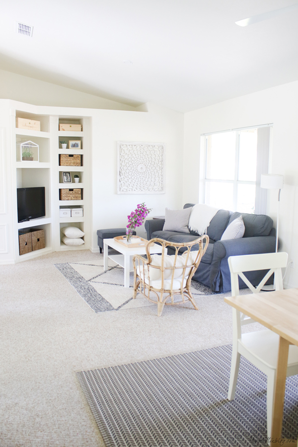 white living room and dining area in one