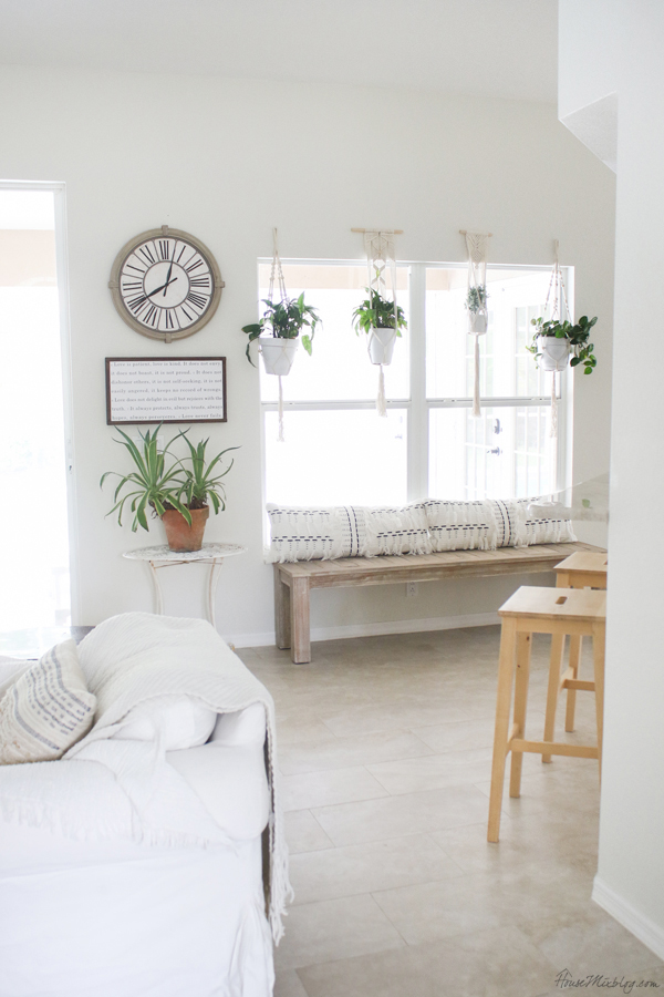 Hanging plants with extra long indoor outdoor bench