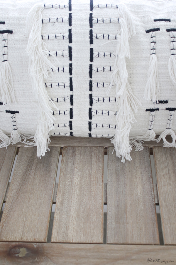 Rustic indoor outdoor bench from world market and black and white lumbar pillows from Home Goods