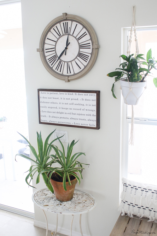 vintage clock, sign and plant stand - blank wall styling