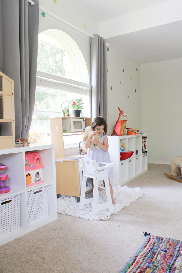 White playroom with pops of color and gray curtains - ikea furniture