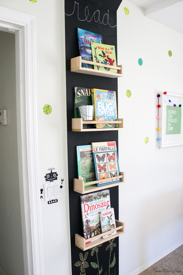 book wall with spice racks and chalkboard wall