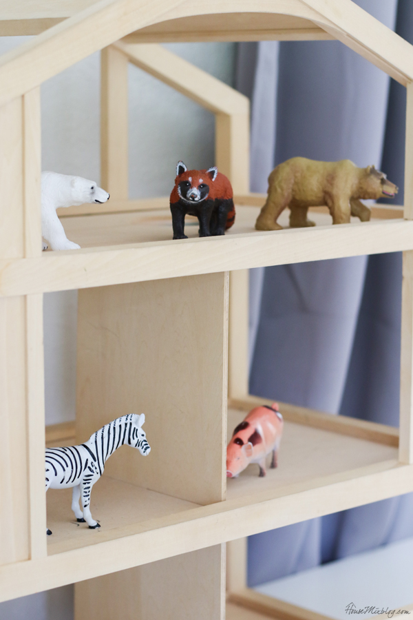 wooden dollhouse in playroom