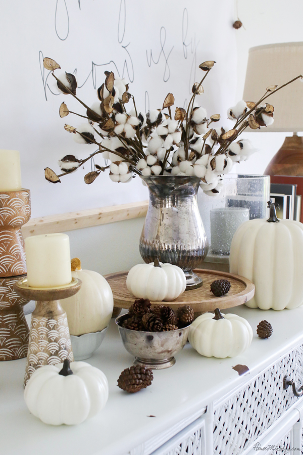 fall decor in woods, creams, cotton stems, and white pumpkins