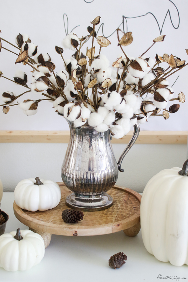neutral fall decor - cotton stems in silver pitcher on dining room buffet table