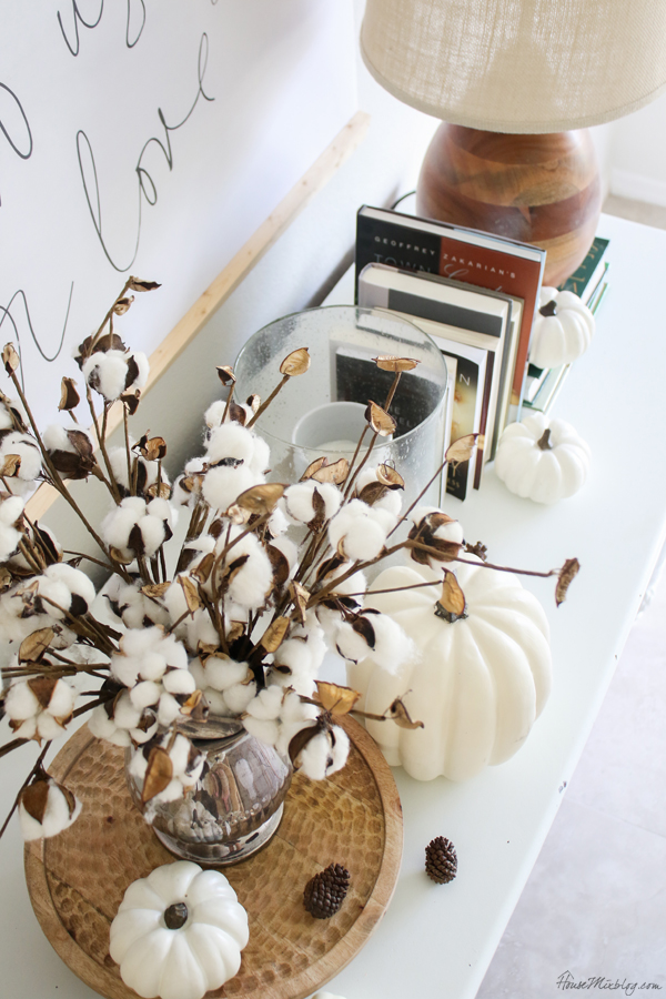 simple fall decor in neutrals - wood, white, cotton stems, candles, books, white pumpkins