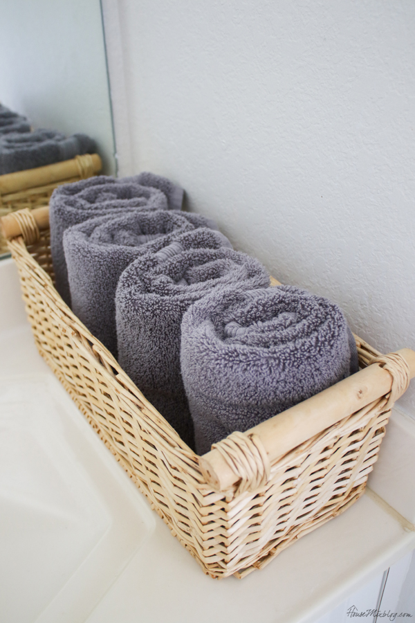 Bathroom organization ideas - gray hand towels to hide stains and makeup