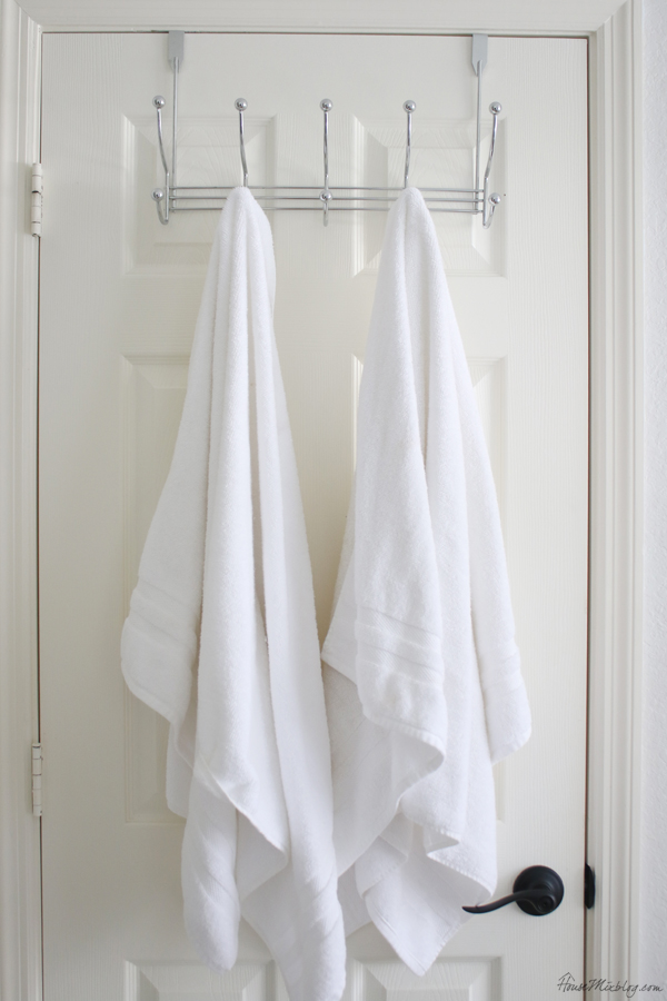Bathroom organization ideas - use an over door hangers to save space