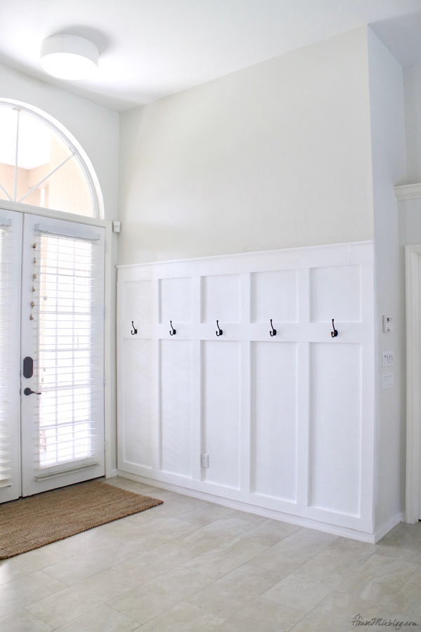 DIY board and batten wainscotting panels with hooks for entryway or mudroom