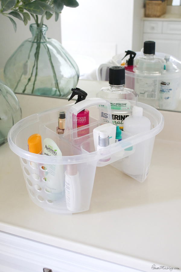bathroom organization ideas and tips - use a caddy that can go under the sink instead of leaving products all over the counter