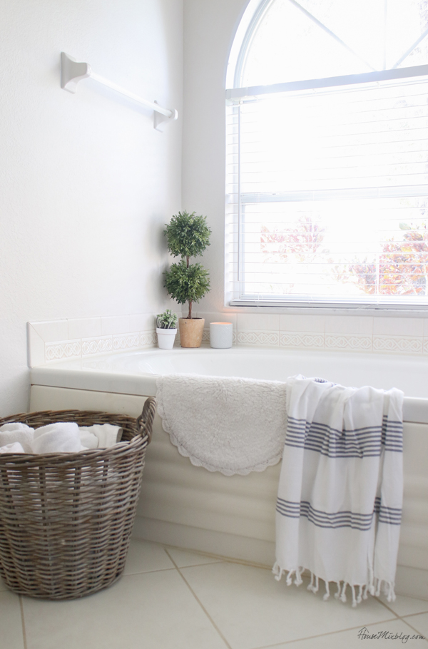 bathroom organization - put towels in basket instead of taking up cabinet space