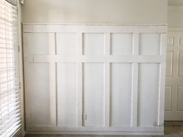 board and batten wall - one coat of paint before caulking