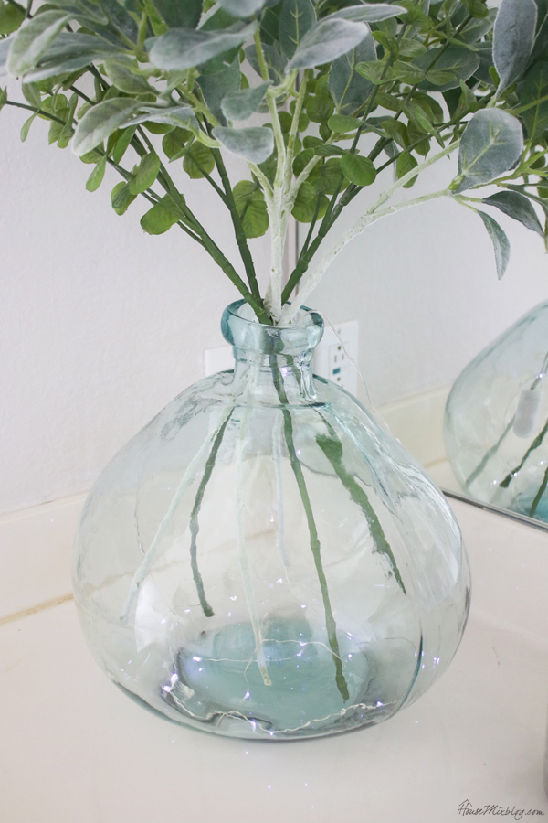 fairy lights on the bottom of a vase for a relaxing bath