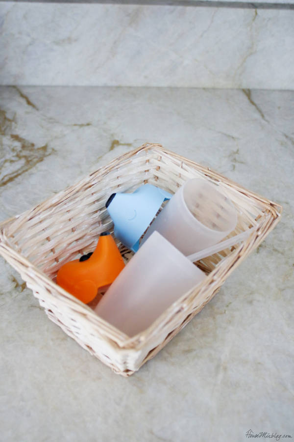 kid kitchen cabinet and dish organization - sippy cup basket