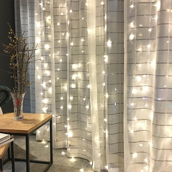 wall of string lights - affordable Christmas decor