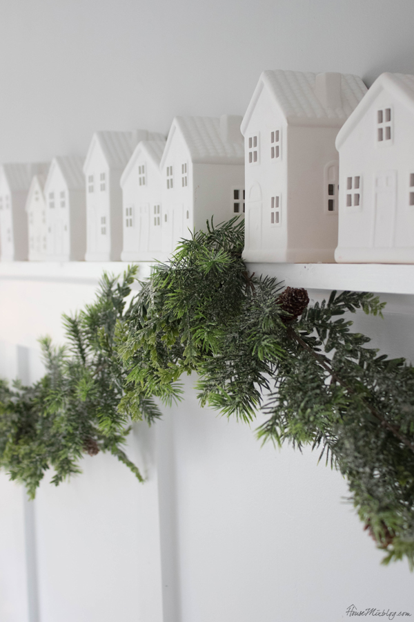 Little white houses ($3) lining the shelf - white and green christmas decorations