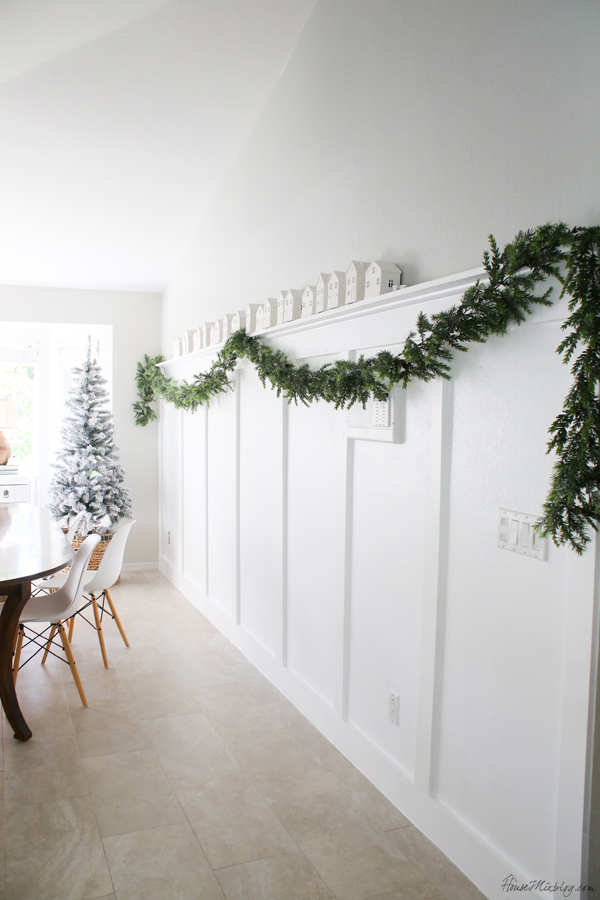 board and batten wall - christmas decor - garland and houses