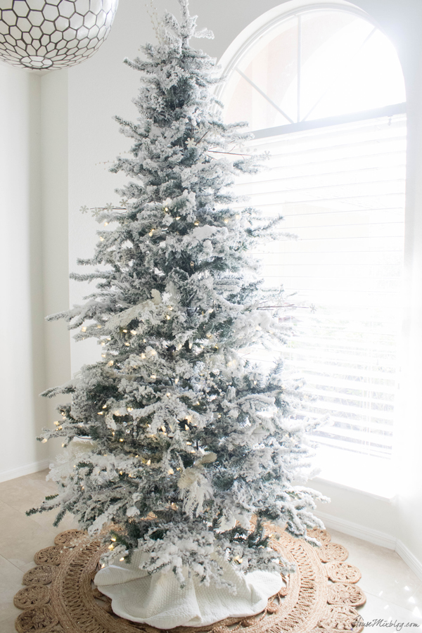 white and neutral flocked christmas tree without ornaments