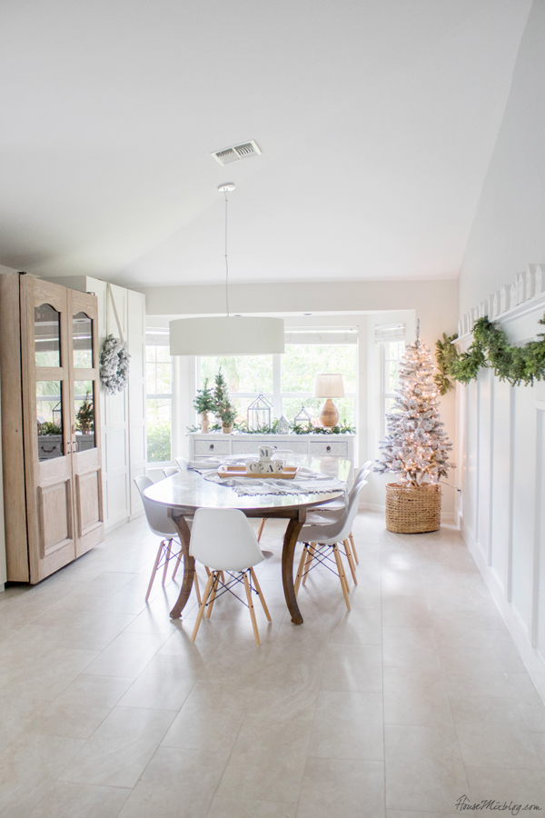 white dining room decorated for Christmas - neutral white and green