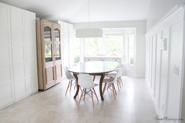 All white dining room with board and batten wall, IKEA PAX wardrobe and rustic wine cooler