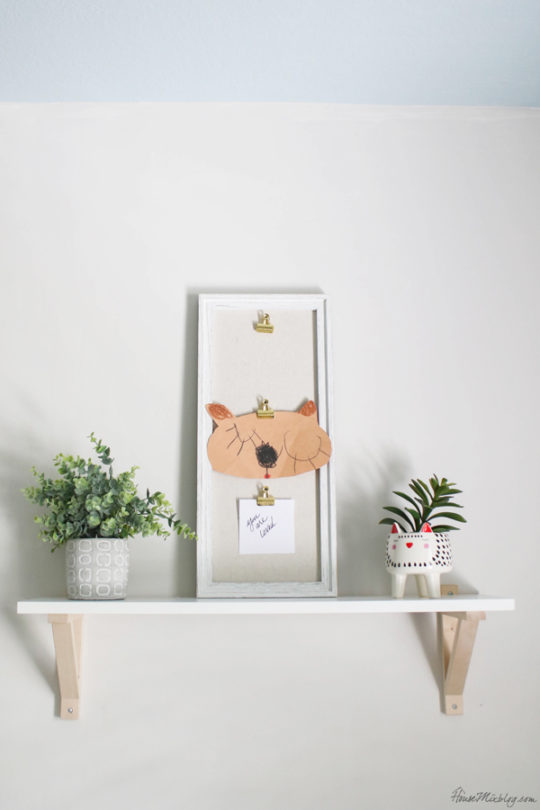 IKEA wall shelf and whimsical cat pot for kids room