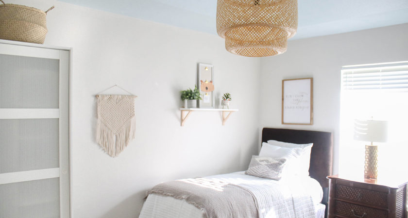 Neutral guest bedroom with IKEA bamboo pendant light and blue ceiling - behr harbor haze