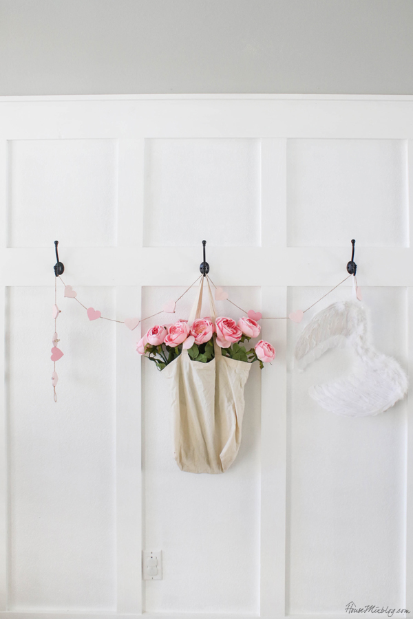 Valentine's entryway with hooks and pink flowers