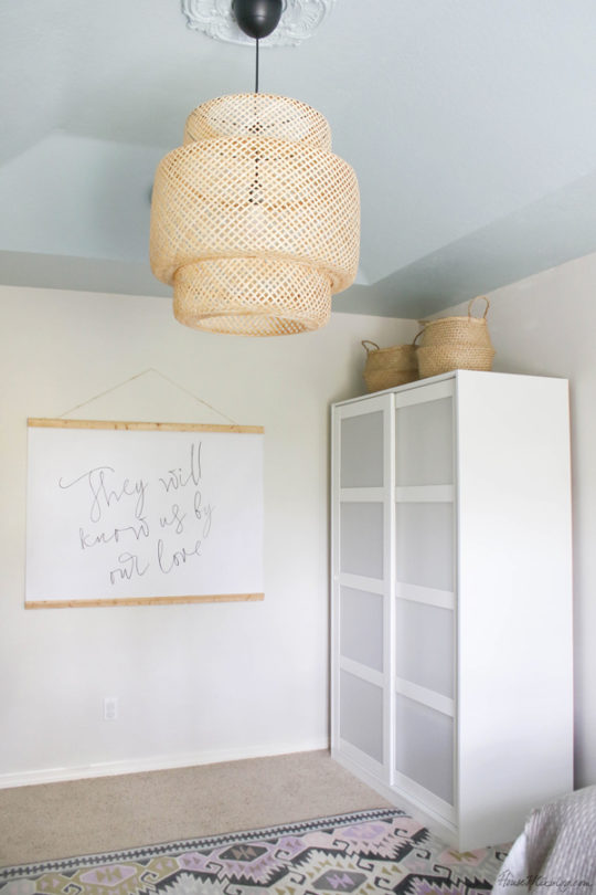 blue ceiling in bedroom with bamboo pendant from IKEA and DIY $10 large scale art