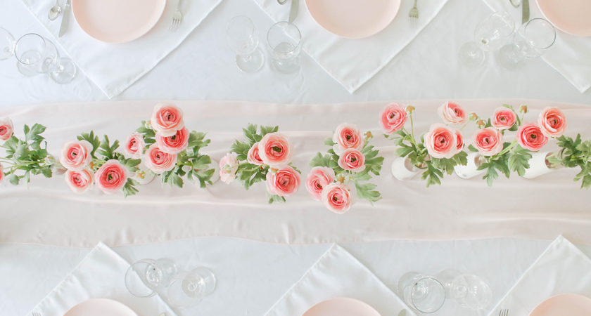 cheap valentine's day centerpiece - pink flowers, dollar store vases, plastic target plates