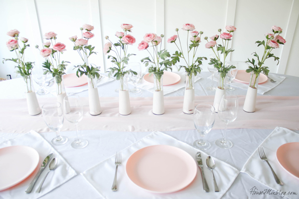 pale pink table setting and centerpiece