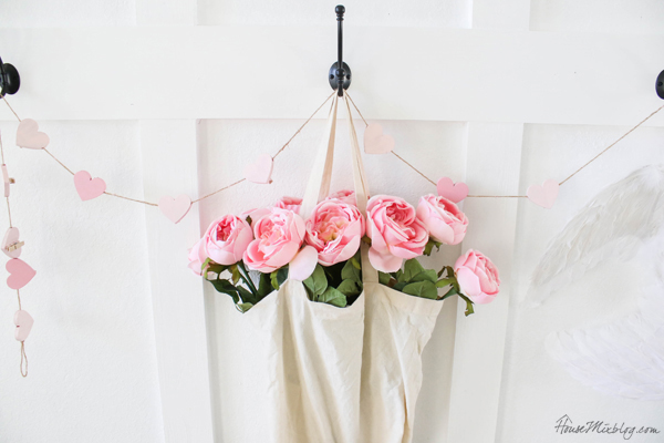 pink decorations with flowers and heart garland