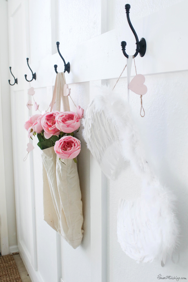 pink flowers and angel wings for valentine's decorations