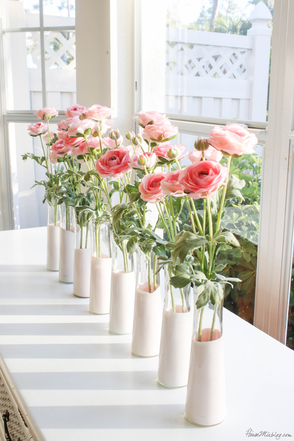 pink roses in pink dipped vases for valentines day centerpiece