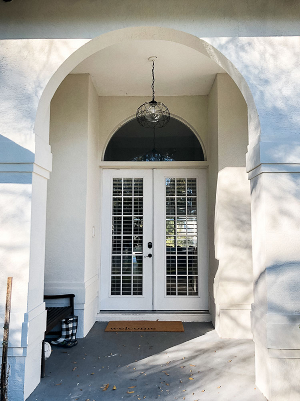 Front porch makeover with paint - before - white french doors