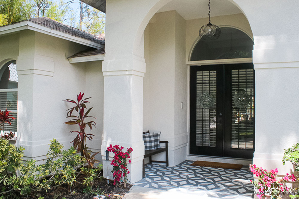Front porch makeover with paint - black french doors and stenciled floor