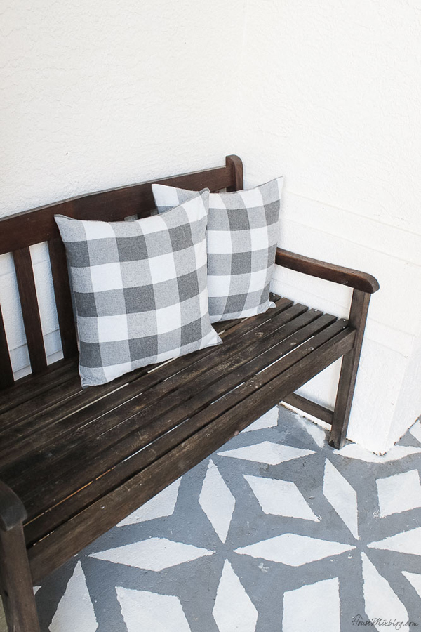 Front porch makeover with paint - cheap pillows - gray buffalo check