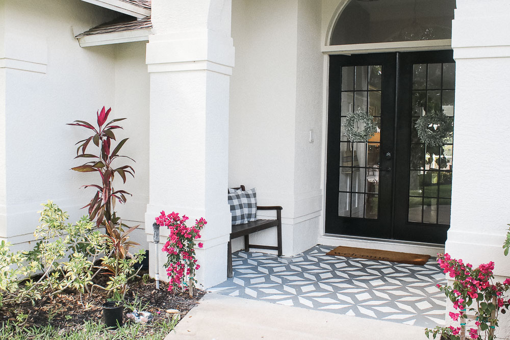 Front porch makeover with paint - white house with black french front doors