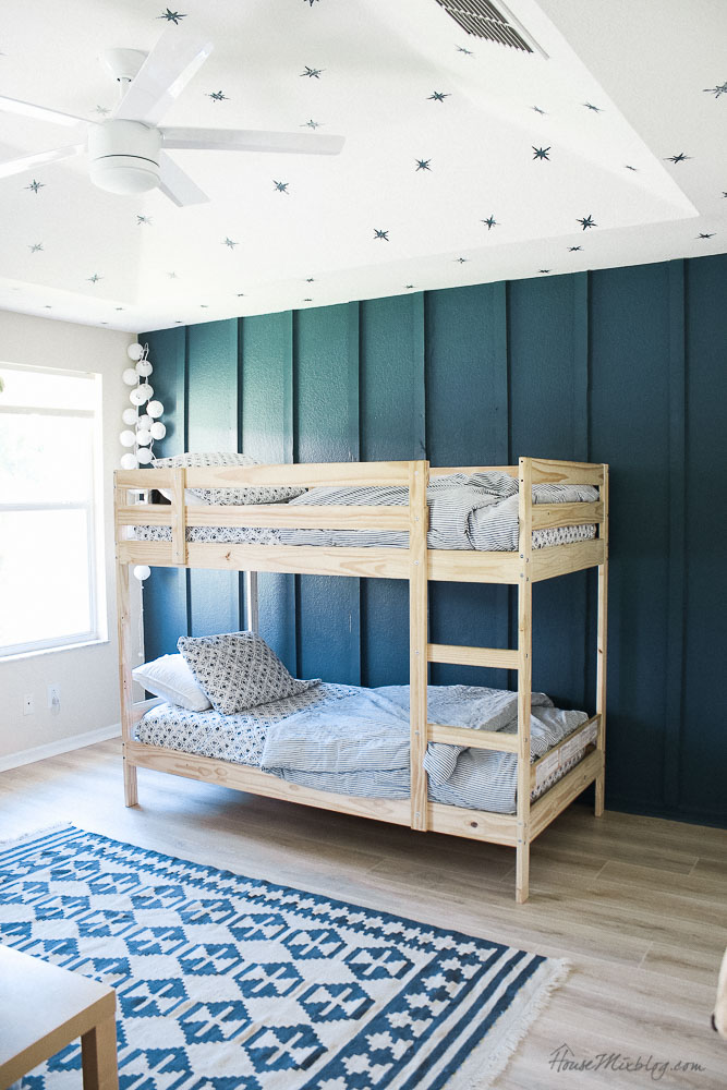 Boys room ideas - blue board and batten accent wall - natural wood bunkbeds - star ceiling - simple white fan