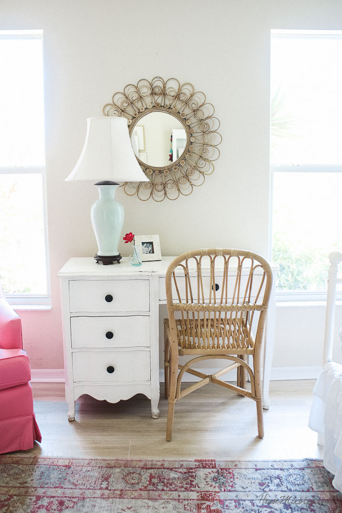 Classic and simple girls room - pink and green - rattan peacock mirror and chair