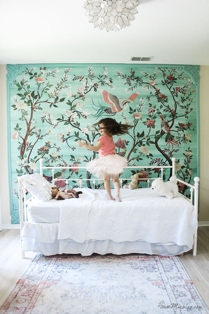 Green garden mural with flowers and birds in little girl's room - anthropologie havenview mural - classic pink and green girls bedroom