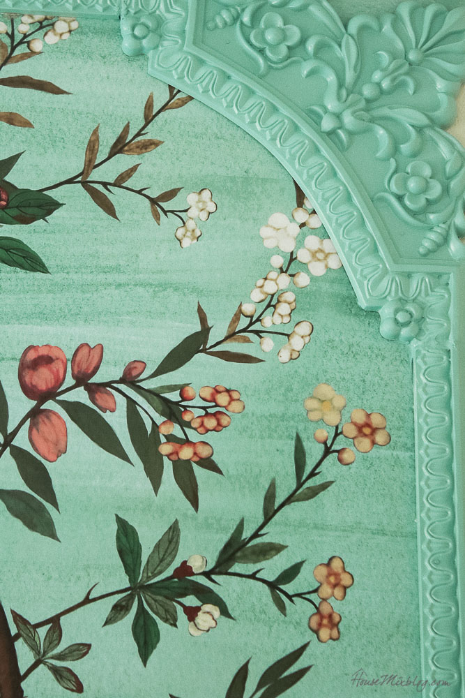 Green garden mural with flowers and birds in little girl's room-framed with green trim