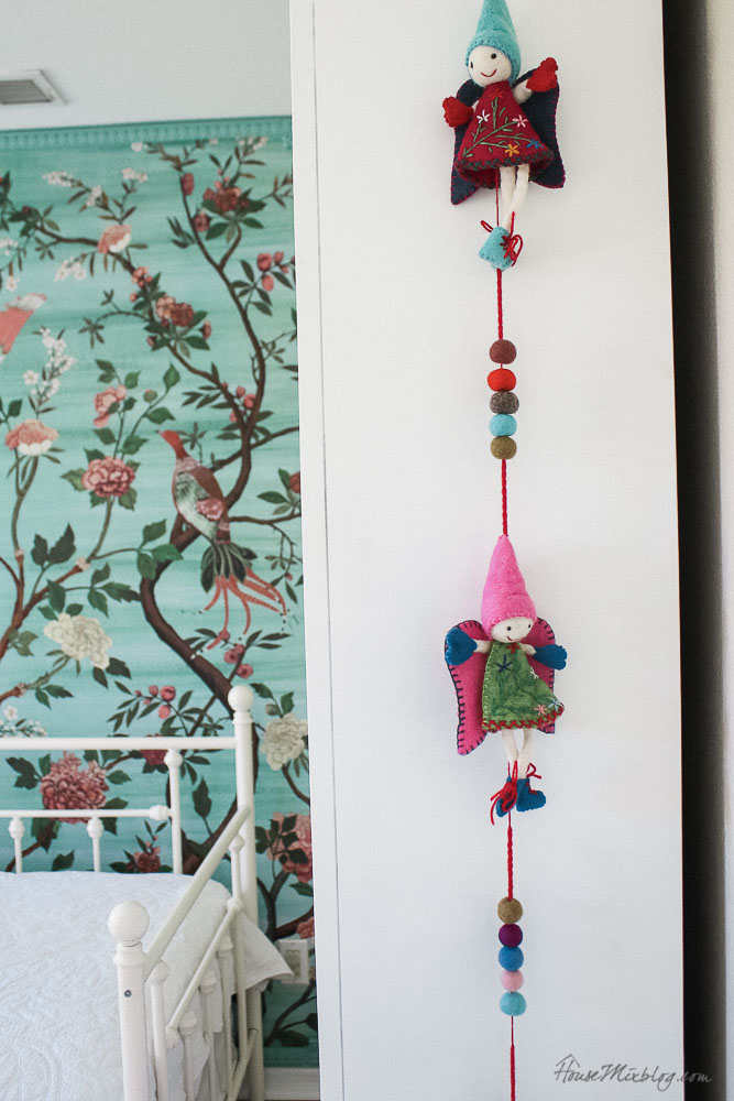 Green garden mural with flowers and birds in little girl's room - hanging felt fairies