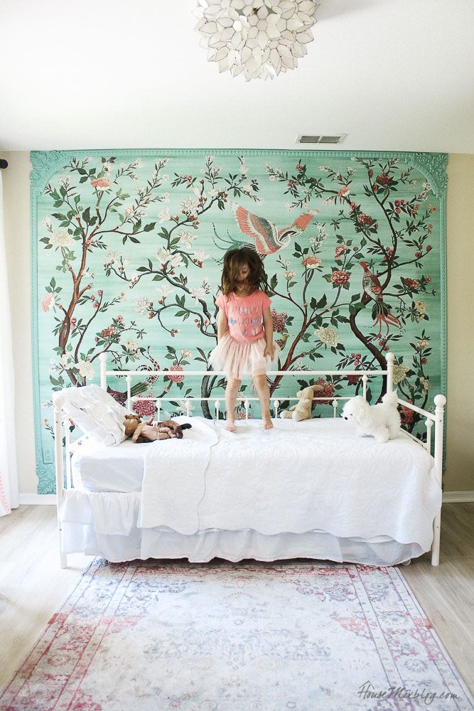Green garden mural with flowers and birds in little girl's room