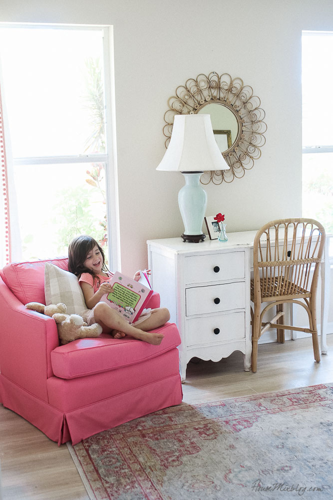 Pink and green girls room - pink armchair - rattan mirror and chair